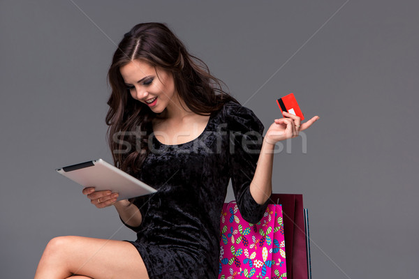 Stock photo: Beautiful young girl paying by credit card for shopping