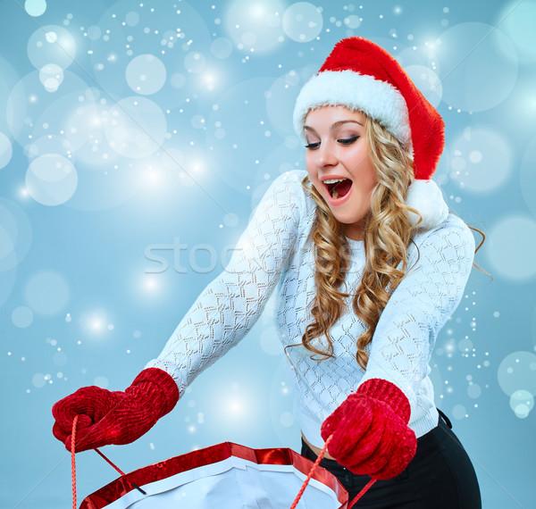 Mooie jonge vrouw kerstman kleding geschenk Blauw Stockfoto © master1305