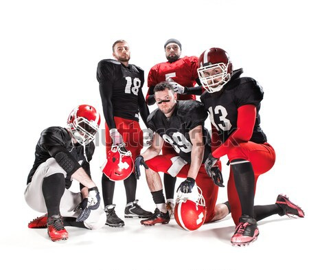 The four american football players posing with ball on white background Stock photo © master1305