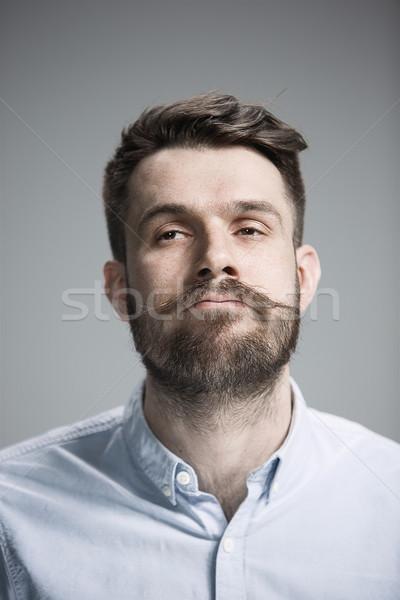 Jóképű büszke fiatalember szürke arc test Stock fotó © master1305