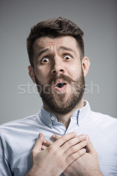 Man is looking imploring over gray background Stock photo © master1305