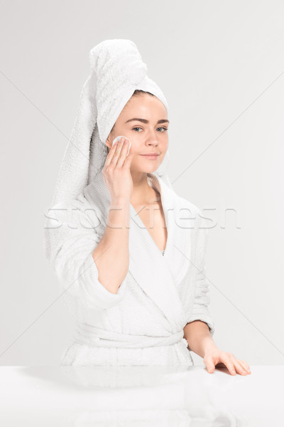 Woman cleaning face in bathroom Stock photo © master1305