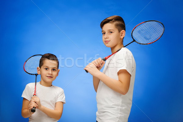 The two boys with  badminton rackets outdoors Stock photo © master1305