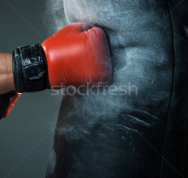 Hand  of boxer and punching bag over black background Stock photo © master1305