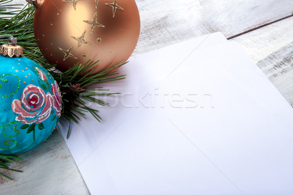 Stock photo: The sheet of paper on wooden table with Christmas decorations