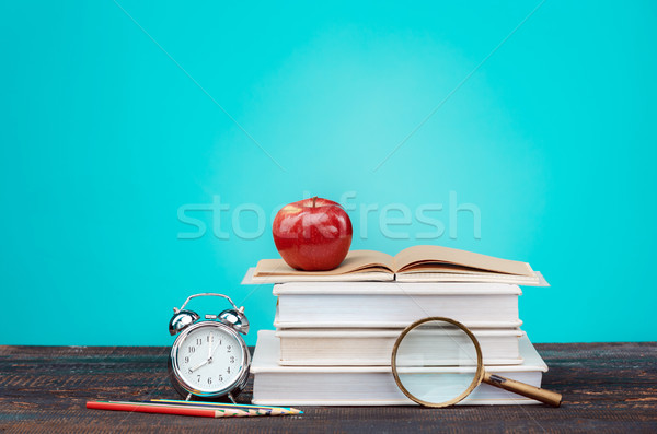 Back to School concept. Books, colored pencils and clock Stock photo © master1305