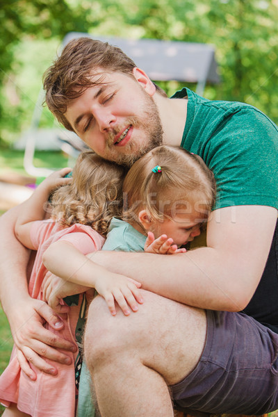 Happy family and father's day. child daughters hugging dad Stock photo © master1305