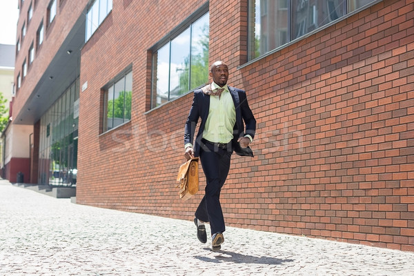 african black young businessman running in a city street Stock photo © master1305
