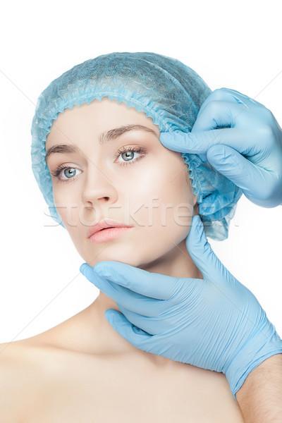 Chirurgie esthétique médecin mains gants toucher visage de femme Photo stock © master1305