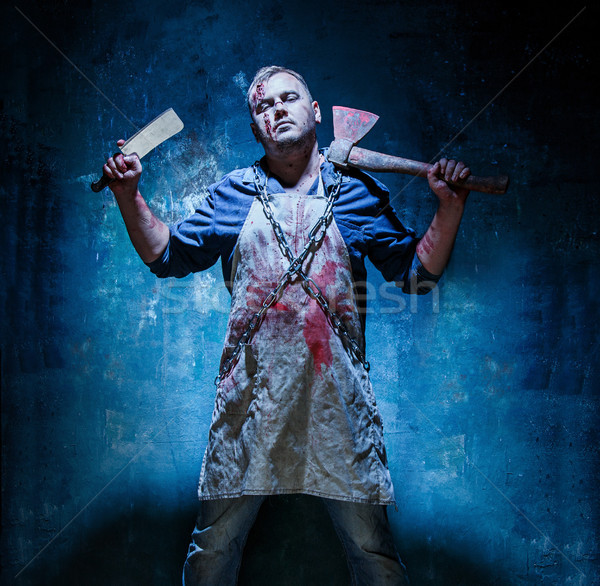 Bloody Halloween theme: crazy killer as butcher with an ax Stock photo © master1305