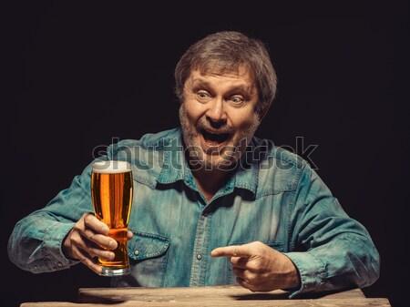 笑みを浮かべて 男 デニム シャツ ガラス ビール ストックフォト © master1305