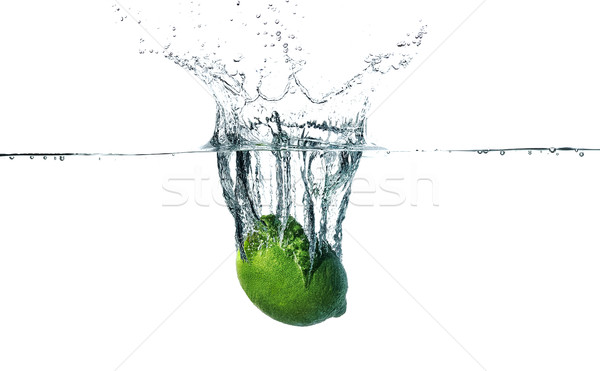 Fresh lime falling into water Stock photo © master1305