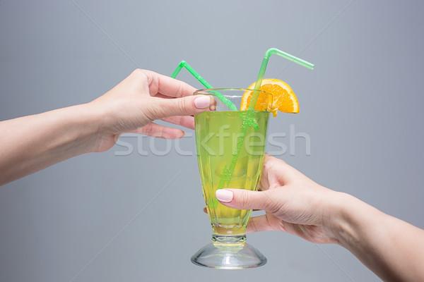 Női kezek koktél szürke buli üveg Stock fotó © master1305