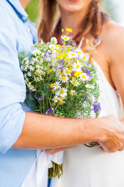 The crop image of romantic couple with flowers Stock photo © master1305