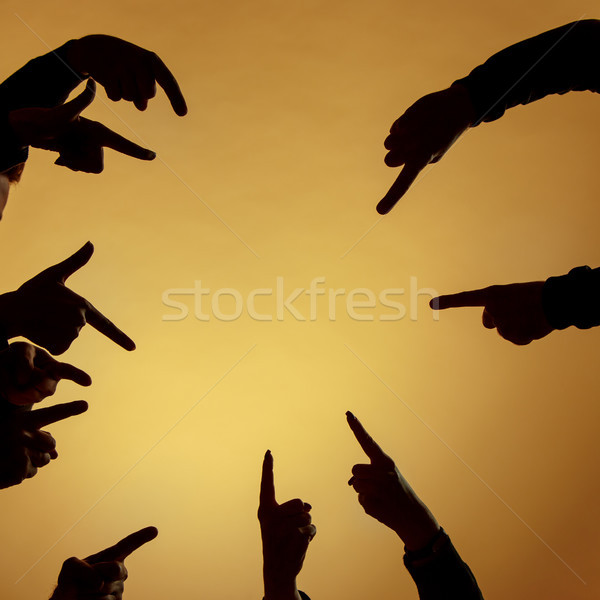 Many hands pointing ahead or out on orange background Stock photo © master1305