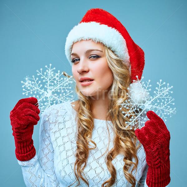 Stockfoto: Mooie · jonge · vrouw · kerstman · kleding · sneeuwvlokken · Blauw