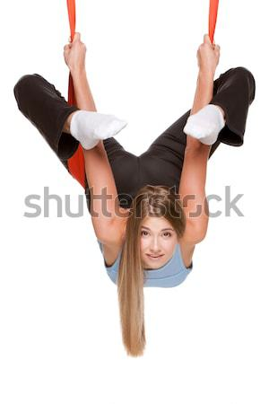 Jonge vrouw antenne yoga hangmat ondersteboven witte Stockfoto © master1305