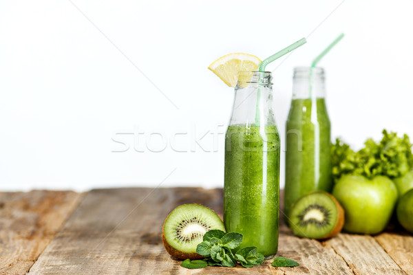 The bottles with fresh vegetable juices on wooden table Stock photo © master1305