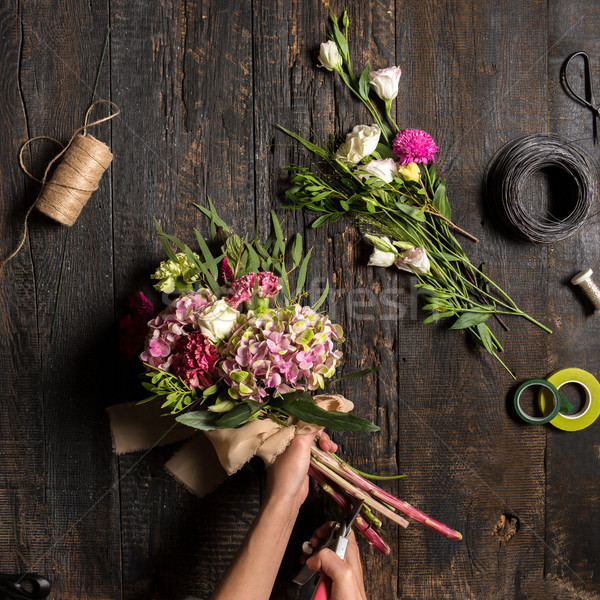 The florist desktop with working tools and ribbons Stock photo © master1305