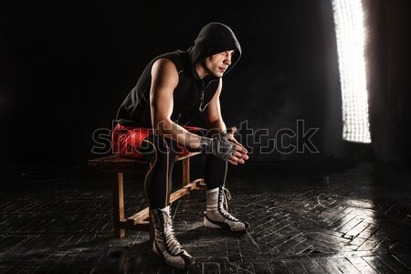 The muscular man sitting and resting on black Stock photo © master1305