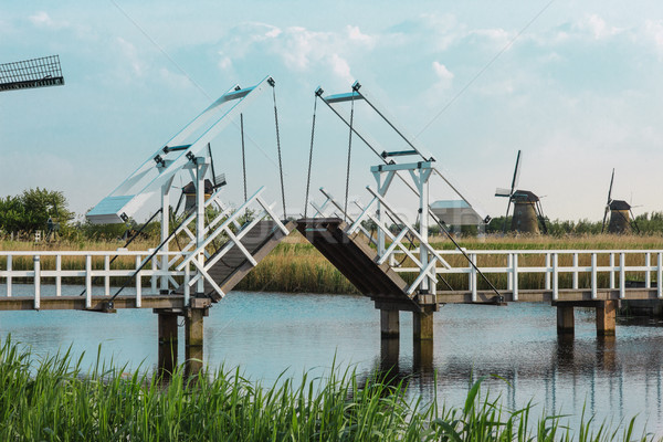 beautiful traditional dutch windmills near the water channels with drawbridge Stock photo © master1305