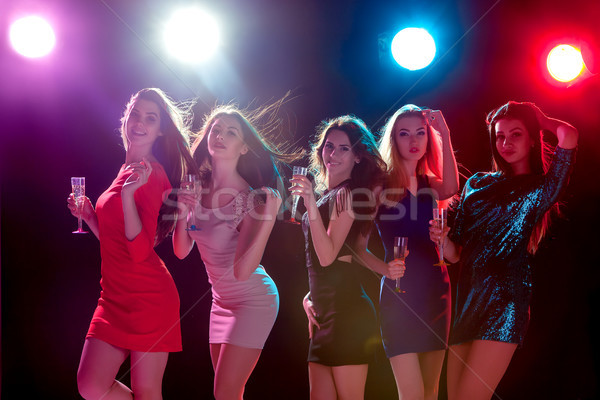 Stock photo: Beautiful girls dancing at the party