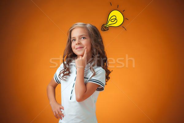 Cute vrolijk meisje oranje portret ontdekking Stockfoto © master1305