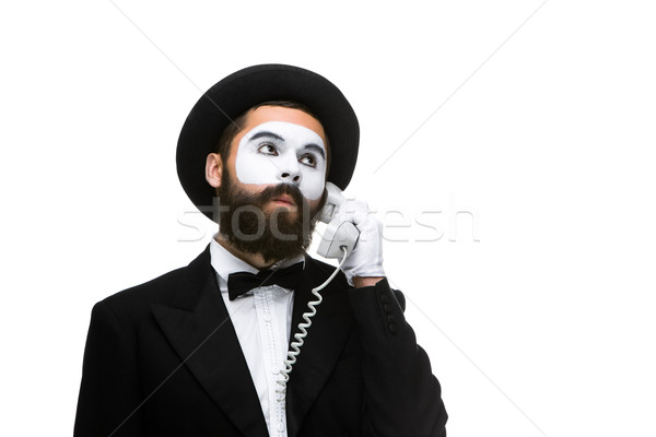 man in the image mime holding a handset.  Stock photo © master1305