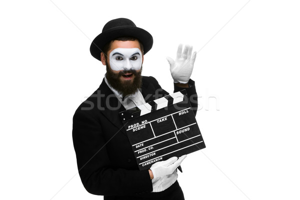 Joyful man in the image mime with movie board Stock photo © master1305