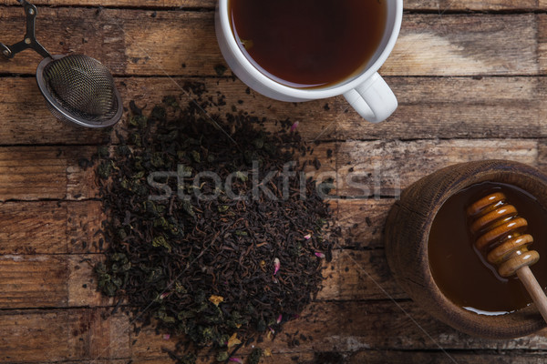 The cup of tea and honey on a wooden table Stock photo © master1305