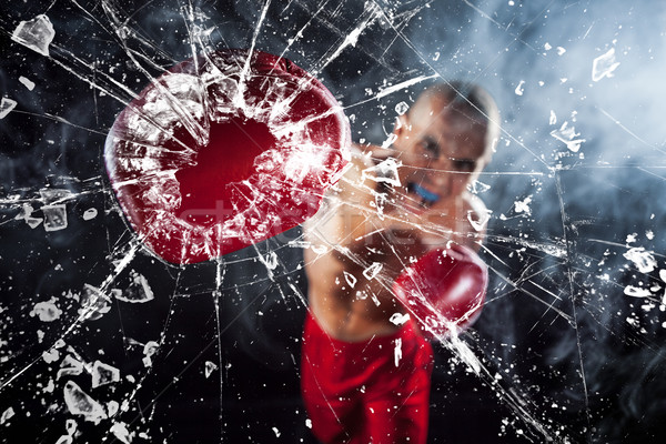 Stock photo: The boxer crushing a glass