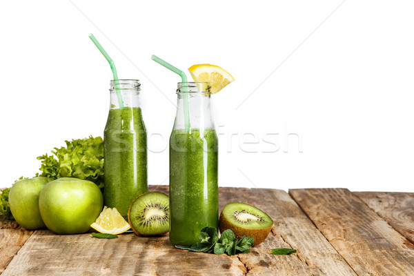 Stock photo: The bottles with fresh vegetable juices on wooden table