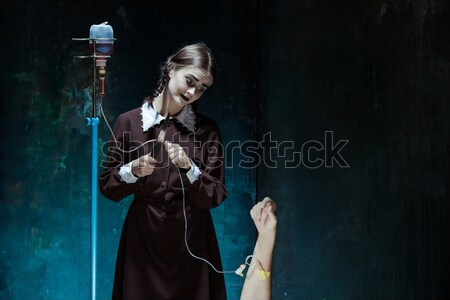 Portrait of a young girl in school uniform as a vampire woman Stock photo © master1305