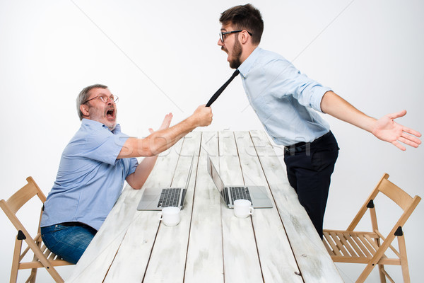 Business conflict. The two men expressing negativity while one man grabbing the necktie of her oppon Stock photo © master1305