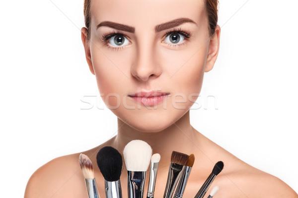 Stock photo: Beautiful female eyes with bright blue make-up and brush