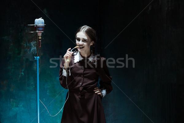 Portré fiatal lány iskolai egyenruha vámpír nő portré csepp Stock fotó © master1305