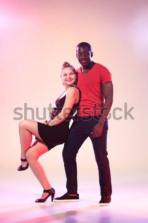 Young couple dances social Caribbean Salsa, studio shot  Stock photo © master1305