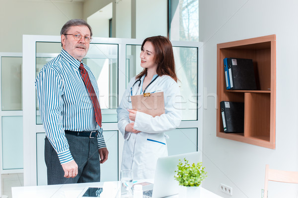 The patient and his doctor in medical office Stock photo © master1305