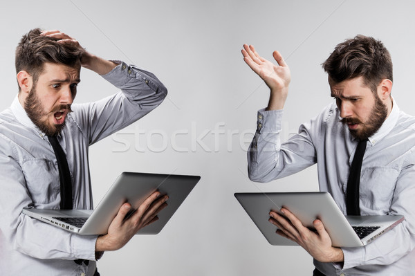 The young confused and frustrated man with his laptop computer Stock photo © master1305