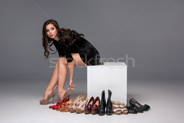 picture of sitting woman trying on high heeled shoes Stock photo © master1305