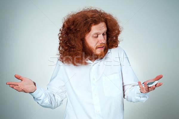 портрет недоуменный человека говорить телефон серый Сток-фото © master1305