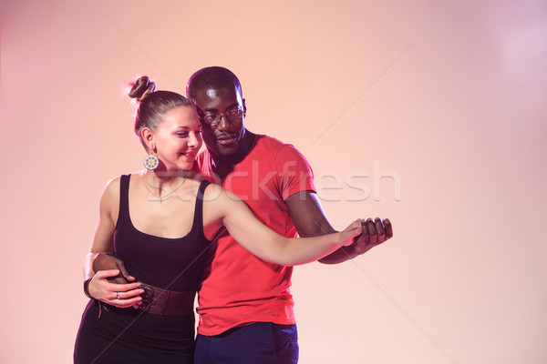 Young couple dances social Caribbean Salsa, studio shot  Stock photo © master1305