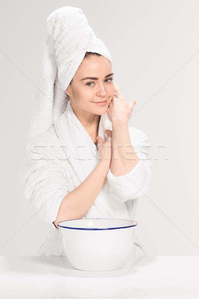 Stock photo: Woman cleaning face in bathroom