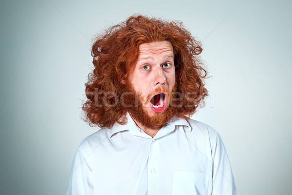 Portré fiatalember megrémült arckifejezés hosszú vörös haj Stock fotó © master1305