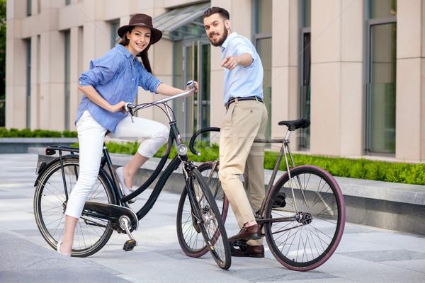 Romantikus randevú fiatal pér biciklik utca mosoly Stock fotó © master1305