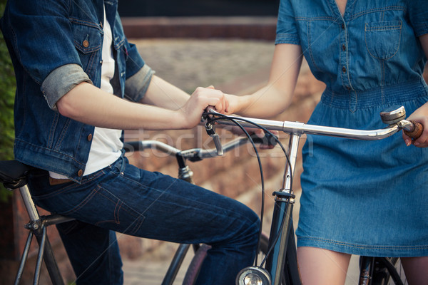 Young couple sitting on a bicycle opposite the city  Stock photo © master1305