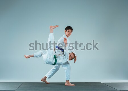 Man in white kimono training karate Stock photo © master1305