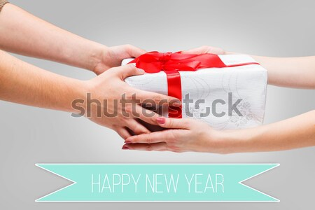 Stock photo: Hands giving and receiving a present