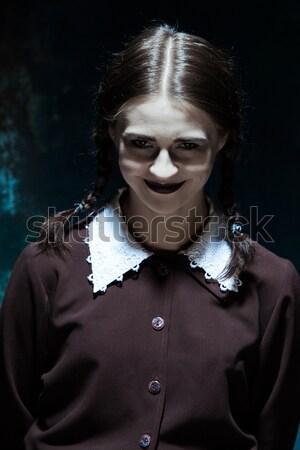 Portré fiatal mosolyog lány iskolai egyenruha gyilkos Stock fotó © master1305