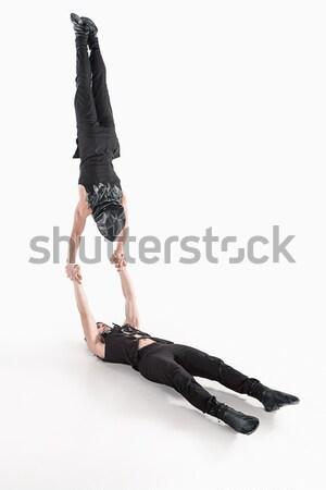 Break dancer doing handstand against  white background Stock photo © master1305